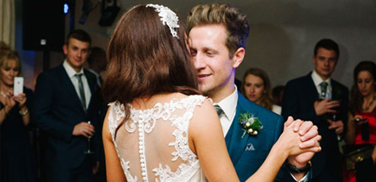 Bride and groom enjoy their first dance together at their Essex wedding venue.