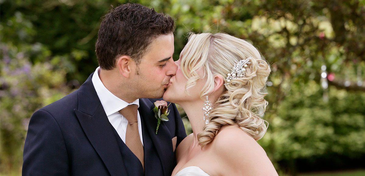 Bride and groom kissing – wedding venues in Essex