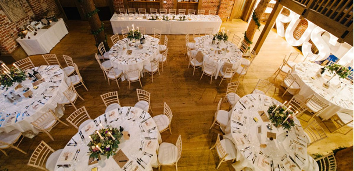 The Mill Barn decorated for a Christmas wedding reception – barn hire Essex.