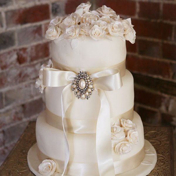 Ivory wedding cake with jewel decorations