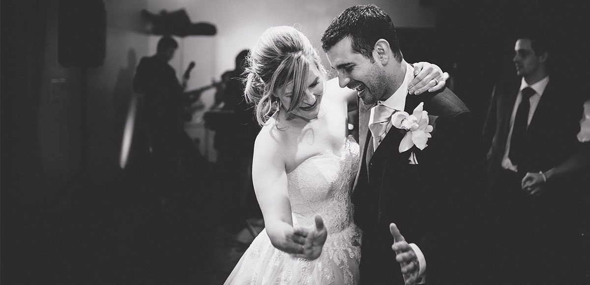 Bride and groom enjoying their first dance.