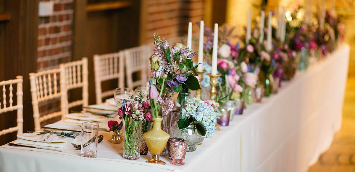 Flowers on the top table for a Gaynes Park wedding