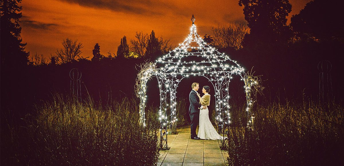 Bride and groom in the gardens at night.