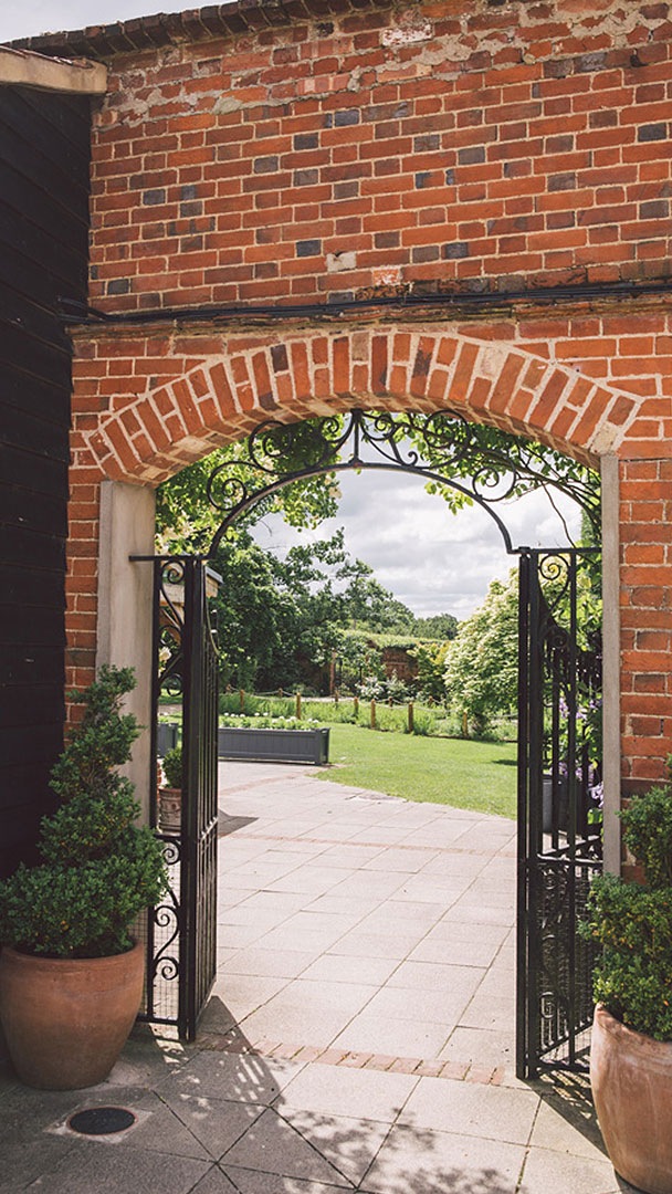 Enjoy exclusive use of this unique barn wedding venue in Essex such as the stunning Walled Garden