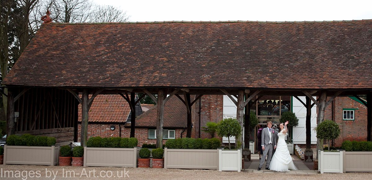 Bride and groom under the Gather Barn at their wedding venue