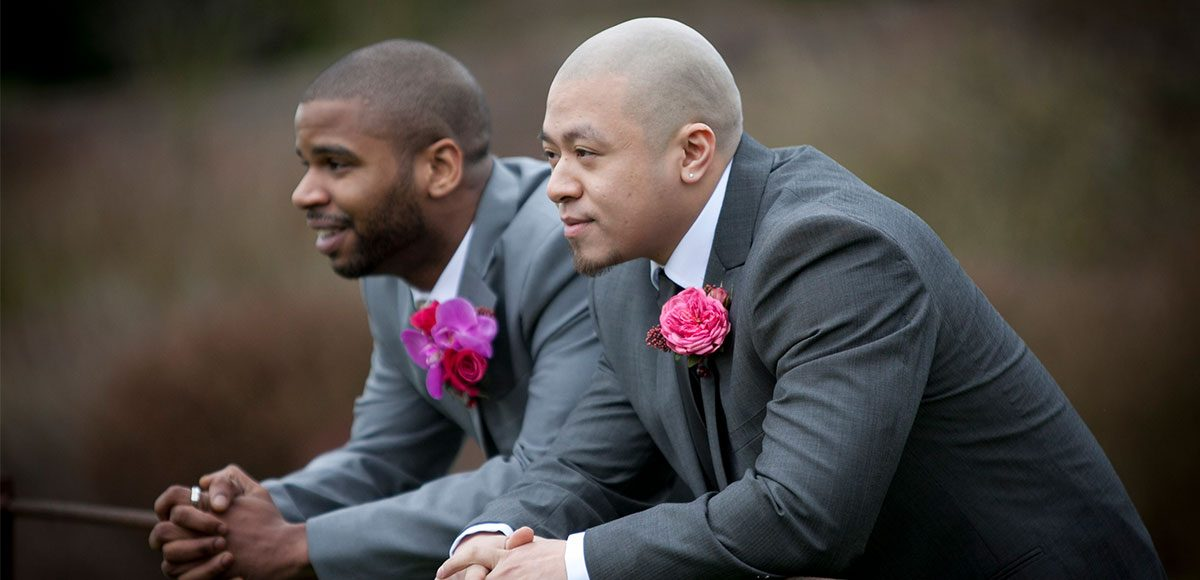 Groomsmen in grey suits ready for the Gaynes Park wedding ceremony