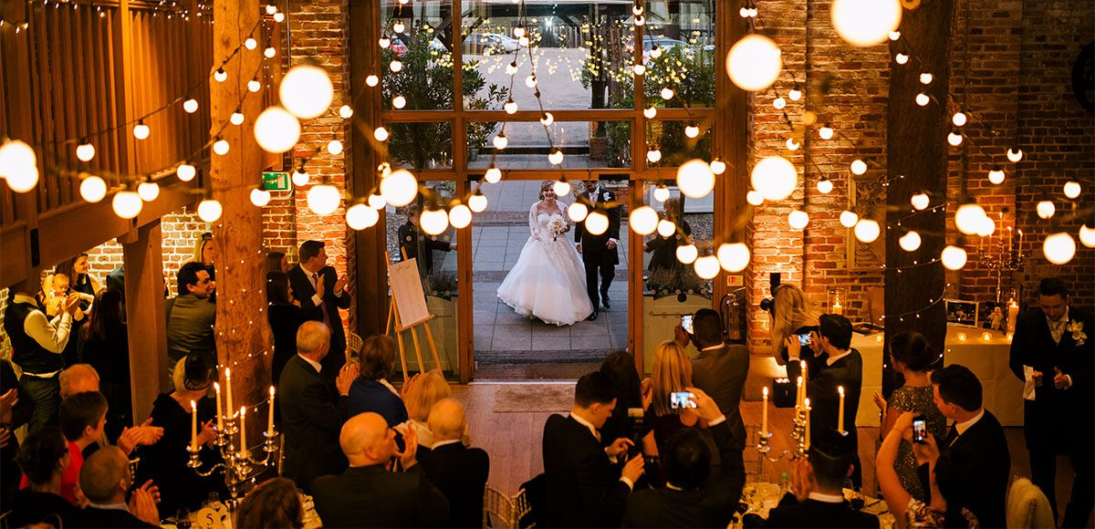 Mill Barn decorated with lights for a winter wedding reception – barn wedding venues in Essex