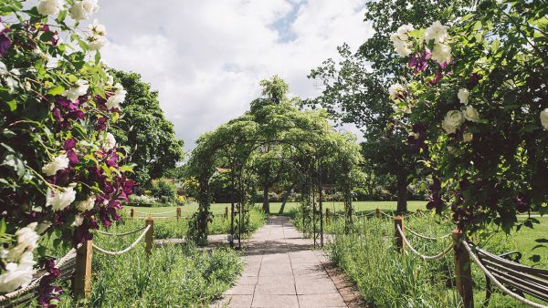 The Walled Garden is full of blooms and home to many seating areas - wedding venues in Essex