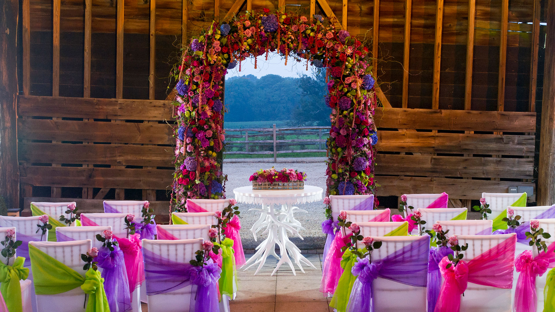 The Gather Barn with rich mahogany beams is perfect for outdoor weddings - wedding barns Essex