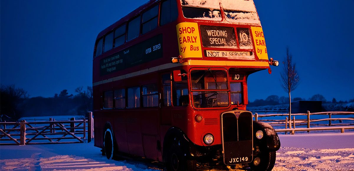 Red vintage bus as wedding transport.
