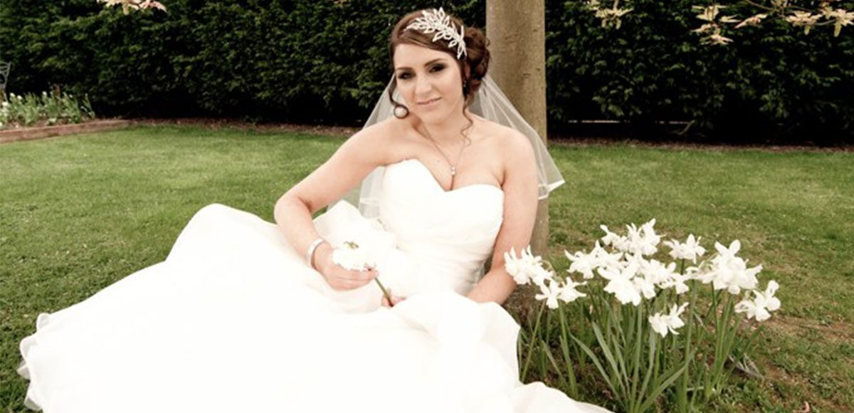 Bride enjoying the Spring gardens at Gaynes Park -wedding venues in Essex