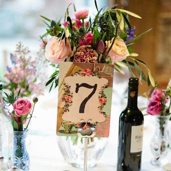 Flowers and table number for a barn wedding reception
