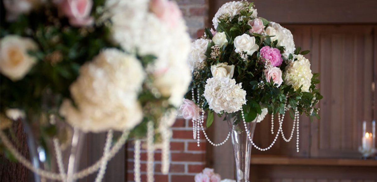 Flowers as centrepiece in the Mill Barn – wedding barns Essex