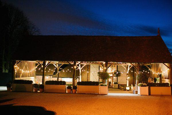 The Gather Barn looks romantic at night lit up with festoon lighting - barn wedding ideas