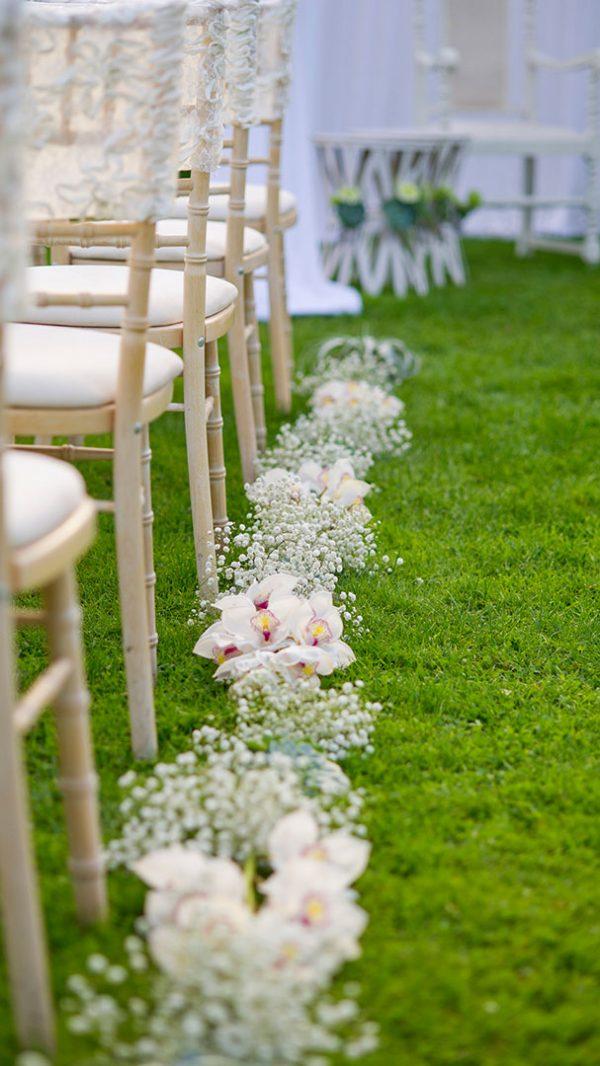 Stunning gypsophila lines the wedding ceremony aisle - white wedding ideas