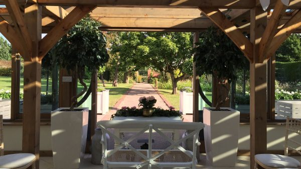 The Long Walk wedding aisle leads to the light and airy Orangery at Gaynes Park wedding venue