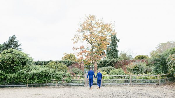 A happy couple make their way to the Long Walk wedding aisle lined with colourful flowers