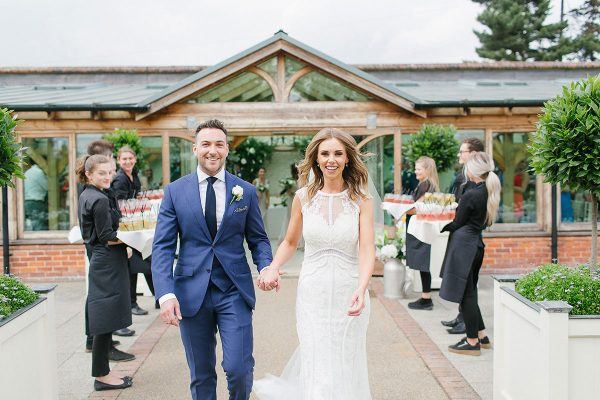 A happy couple smile after saying their marriage vows in the Orangery - ceremony wedding venues in Essex