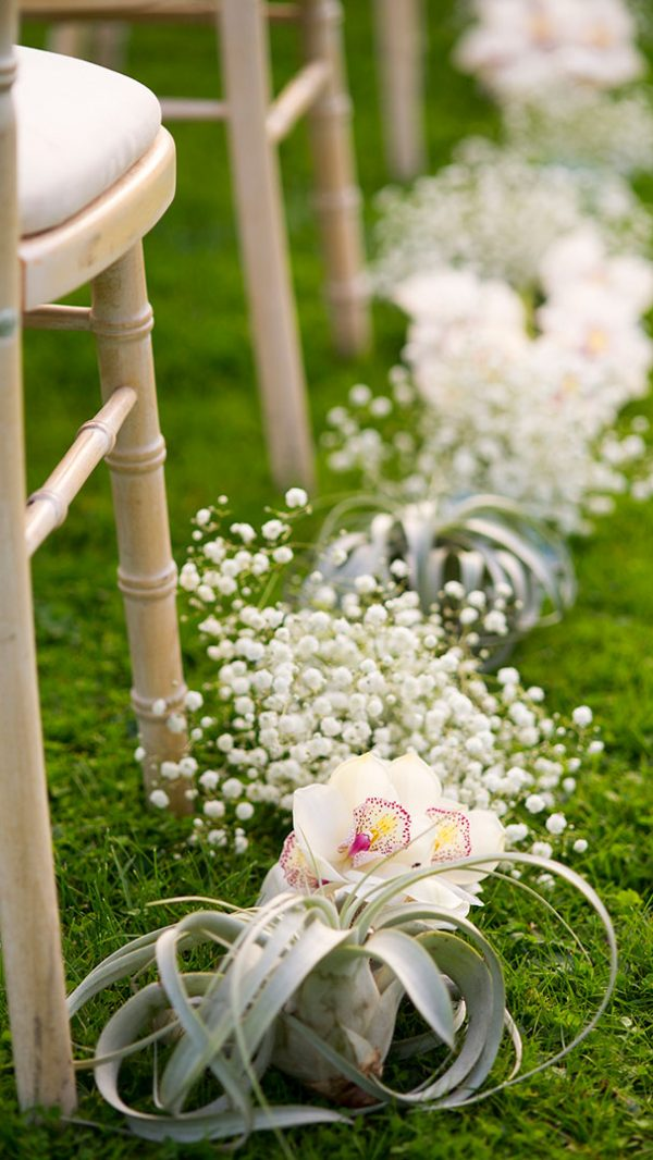 A wedding aisle lined with wedding flowers for an elegant and stylish look - wedding ideas