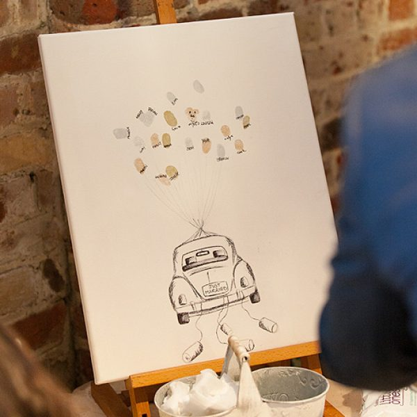 A personalised fingerprint canvas guestbook idea