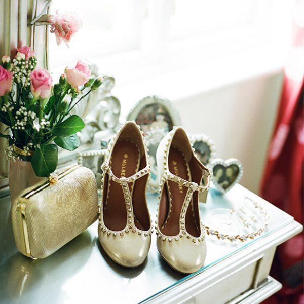 Gold wedding shoes ready for a Gaynes Park wedding ceremony