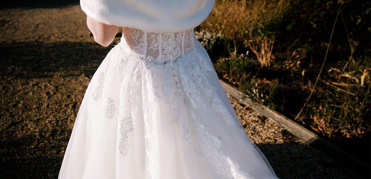 Winter wedding dress and white fur shawl for a Gaynes Park wedding – wedding barns Essex