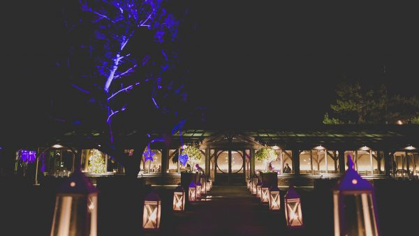 The Long Walk outdoor wedding aisle is lined with lanterns at night - romantic wedding venues in Essex