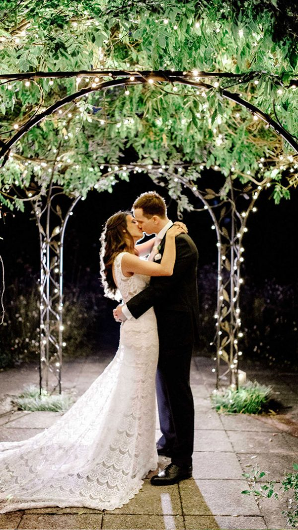 Summer nights bring romantic wedding photo opportunities outside in the evening