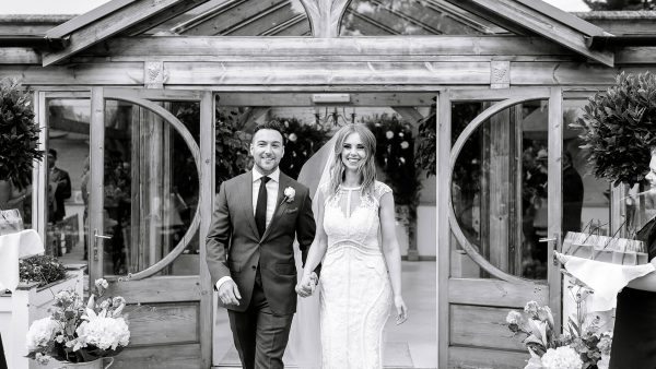 A bride and groom are happy after saying their marriage vows at this beautiful barn venue in Essex