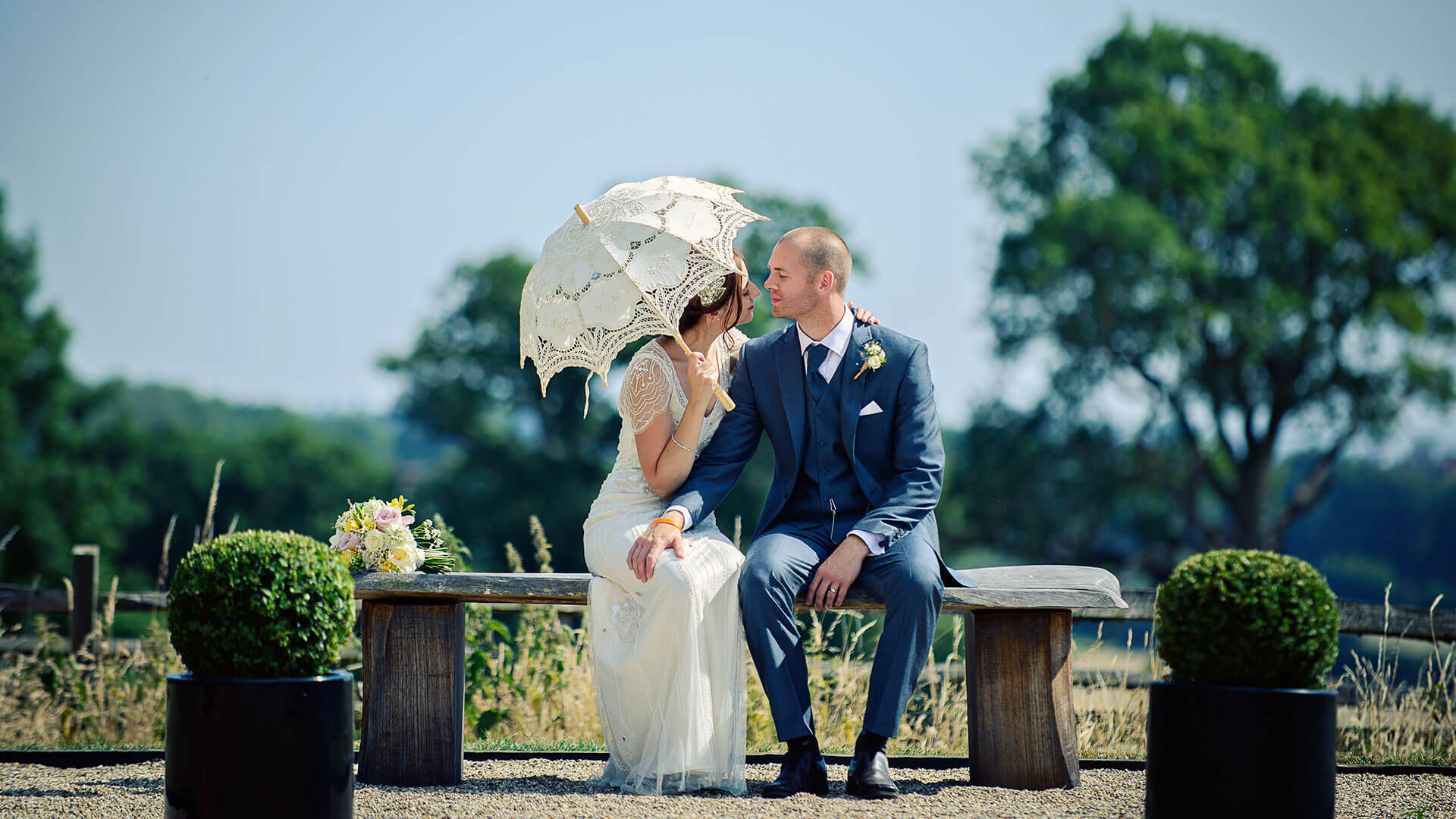 A bride holds a vintage wedding parasol as the perfect accessory for a summer wedding - wedding ideas