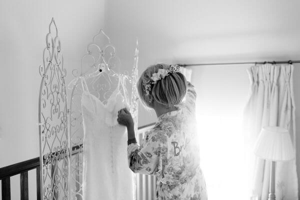 A bride gets ready in the cosy and charming Apple Loft Cottage perfect for your wedding day and night