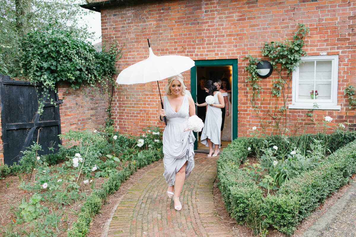 A bridesmaids leaves the honeymoon cottage holiday a vintage wedding parasol – wedding ideas