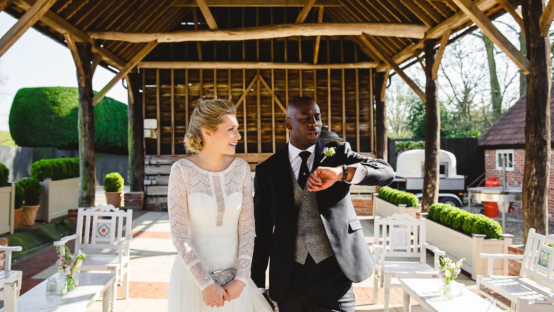 A groom stands with his bride in the Gather Barn licensed for wedding ceremonies - outdoor weddings
