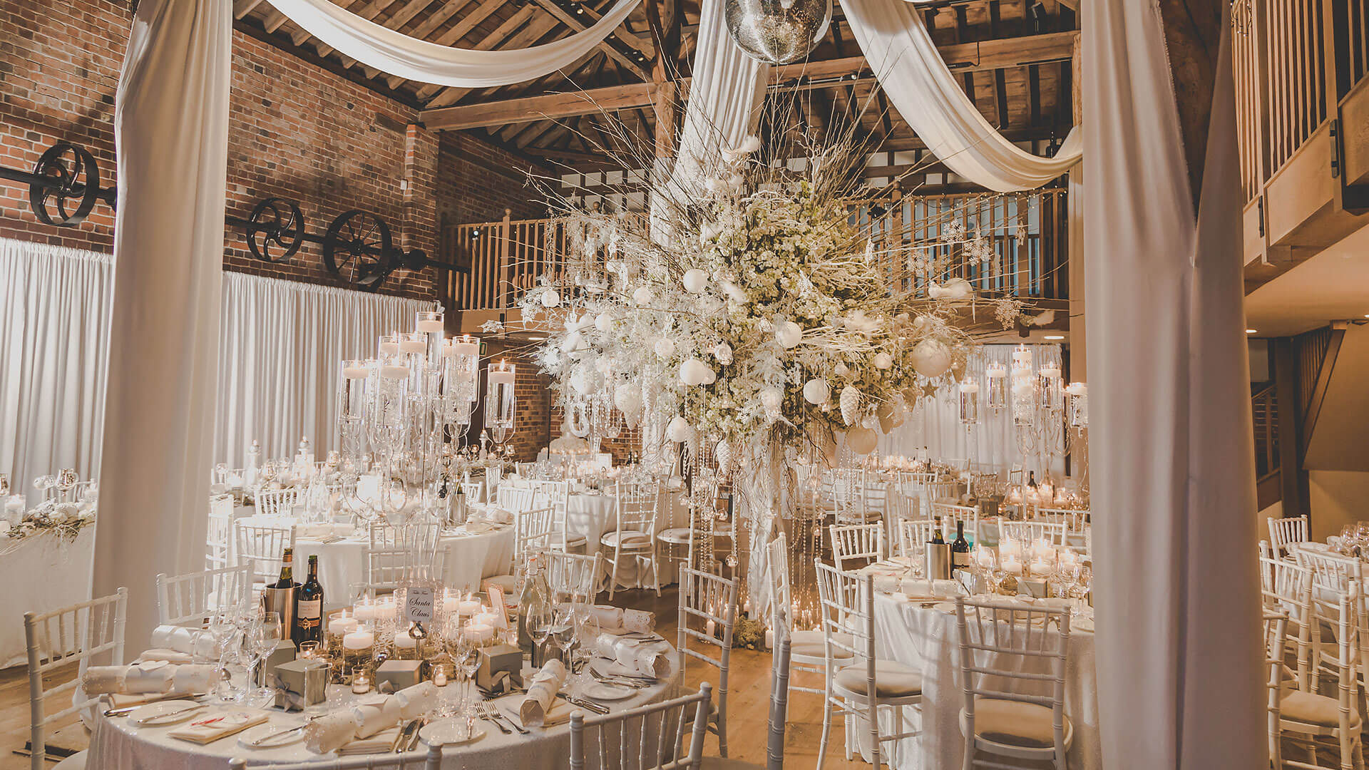 Gaynes Park barn wedding venue is decorated beautifully for a winter wedding with white wedding theme