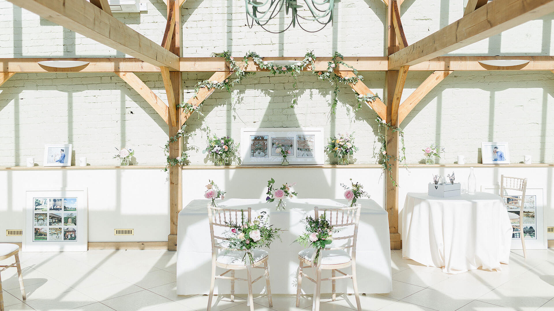 The Orangery looks beautiful with flora wrapped around the oak beams - spring wedding ideas