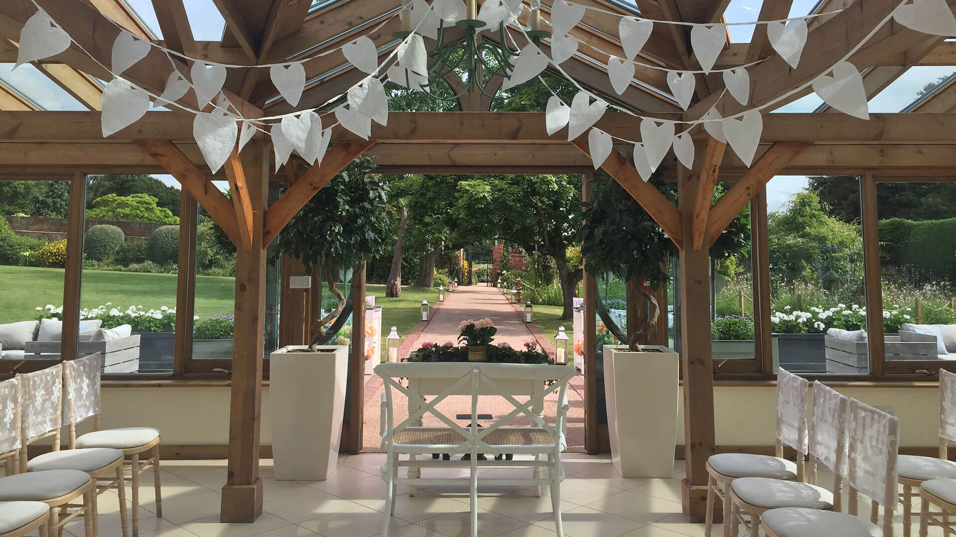 Decorate the Orangery in white heart paper bunting - summer wedding ideas