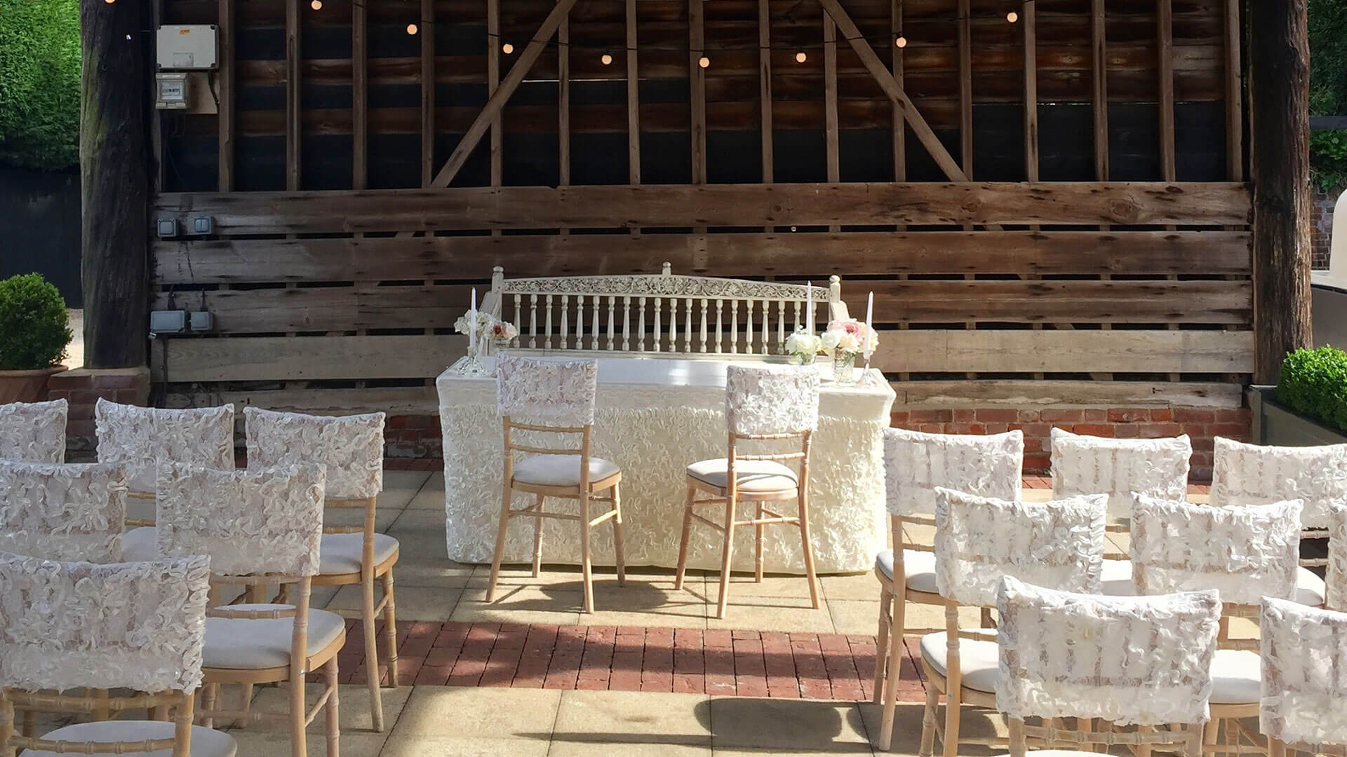 Beautiful lace wedding chair covers and white wedding theme looks stunning in the Gather Barn