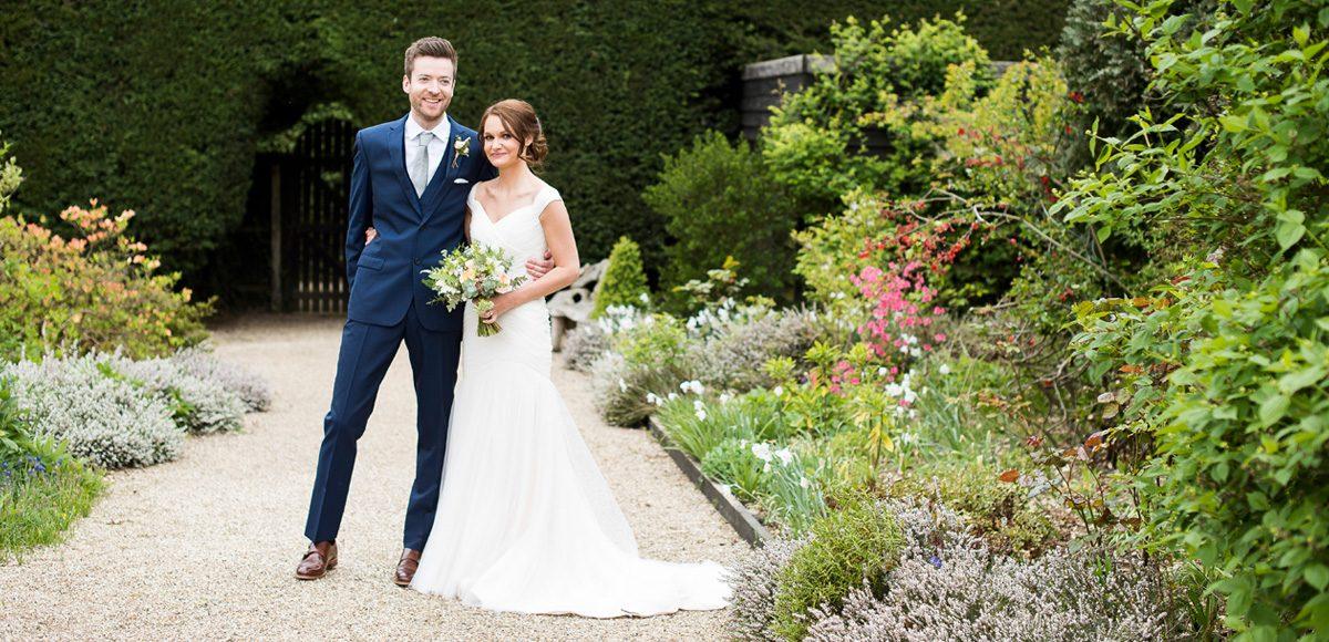 Bride and groom enjoying the Walled Gardens at Gaynes Park wedding venue in Essex