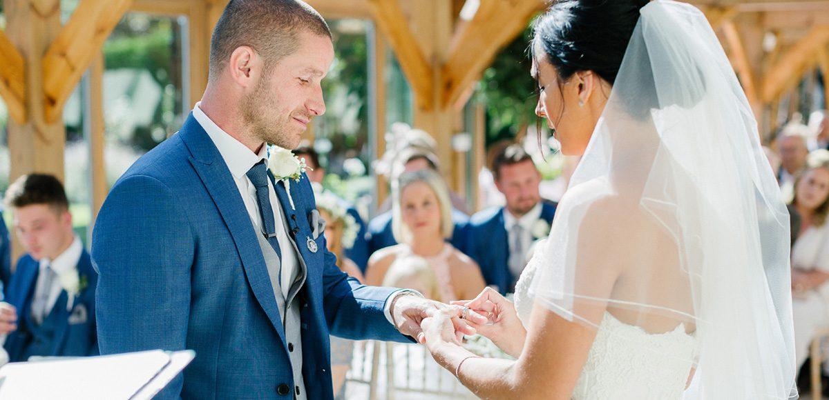 Bride and groom exchanging vows inside the Orangery at Gaynes Park – wedding venues in Essex