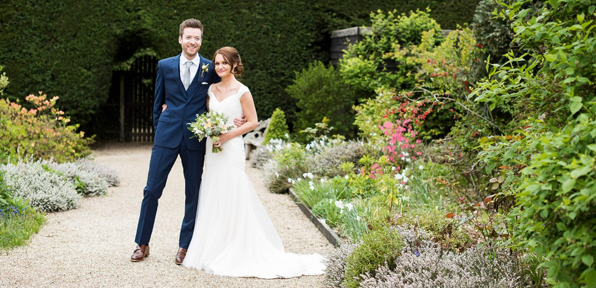 Bride and groom in the gardens of Gaynes Park – Essex wedding venues