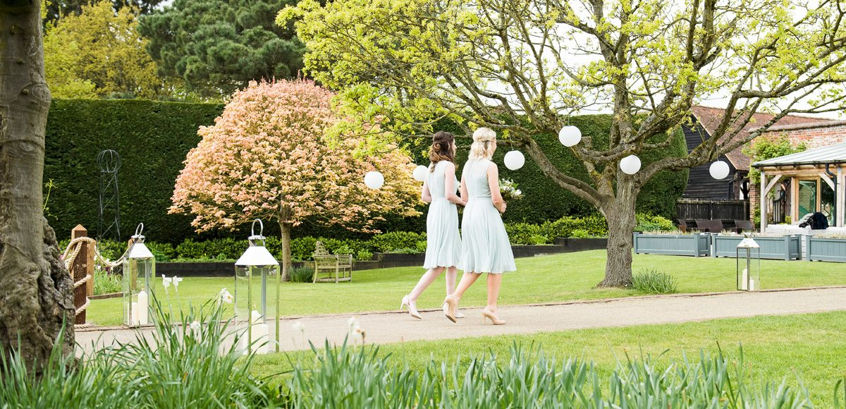 Bridesmaids walking down the Long Walk towards the Orangery