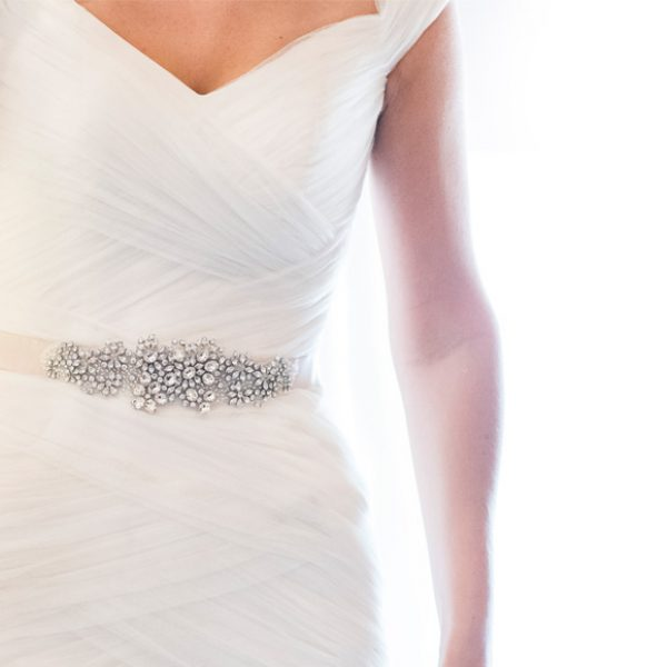 Embellished belt on bride's wedding dress