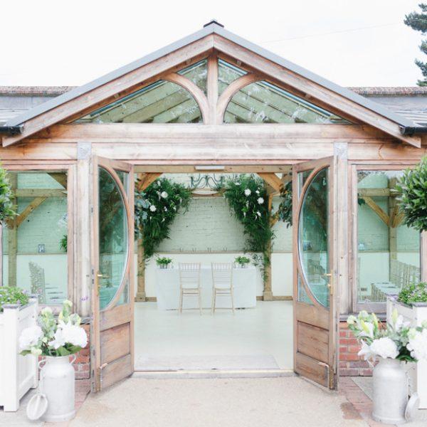 The Orangery at Gaynes Park wedding venue set up for a ceremony