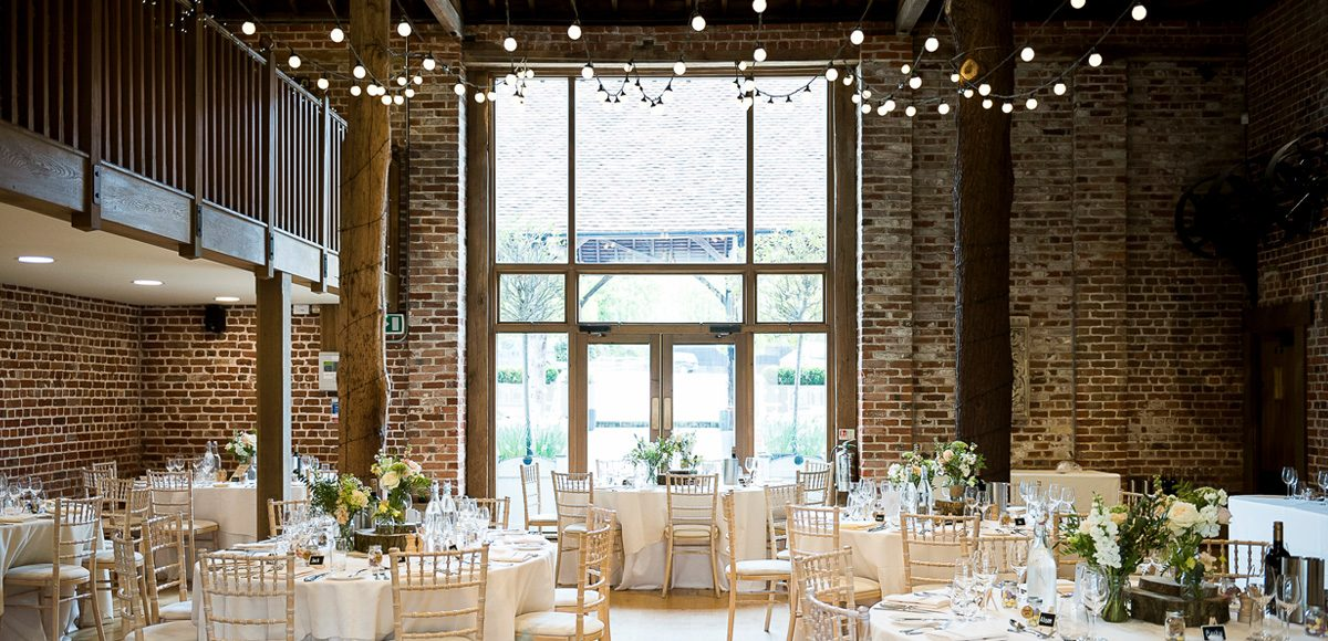 The Mill Barn set up for a wedding reception at Gaynes Park – wedding venues in Essex