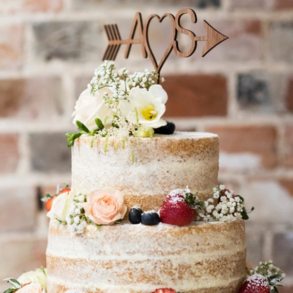 Naked wedding cake and cake topper