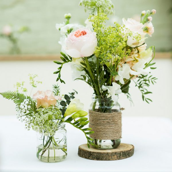 Rustic Mason jars used for wedding flowers and decorations