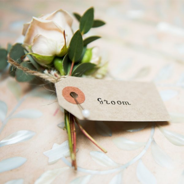 A rose buttonhole for the groom