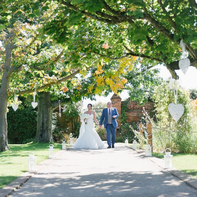 Bride and Groom enjoying the gardens at Gaynes Park, Essex