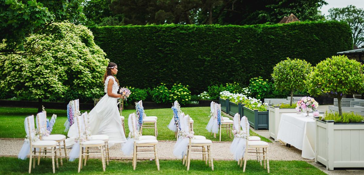 Outdoor wedding ceremonies at gaynes park wedding ideas gaynes park save a beautiful bride walks down the long walk making her way to the outside wedding ceremony junglespirit Gallery
