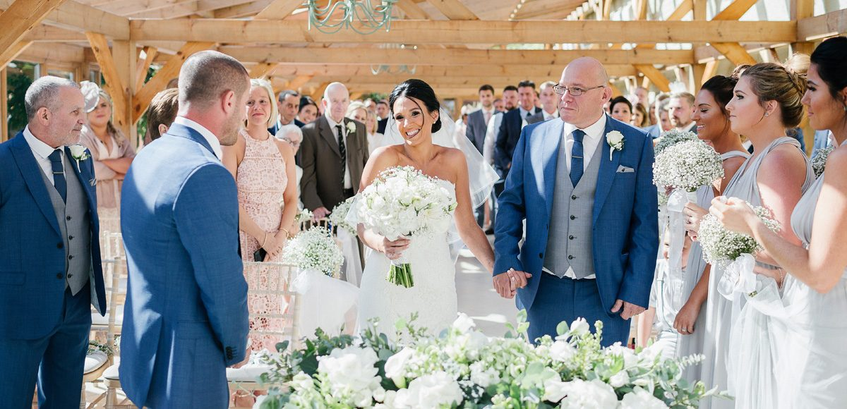 Father of the bride giving away his daughter in the Orangery